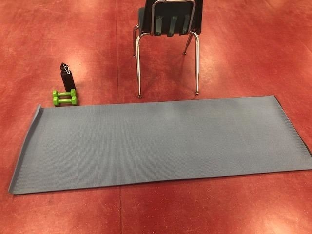 A reviewer shoes their mat rolled out on the floor
