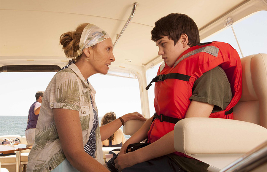 Toni Collette and her son in a life jacket
