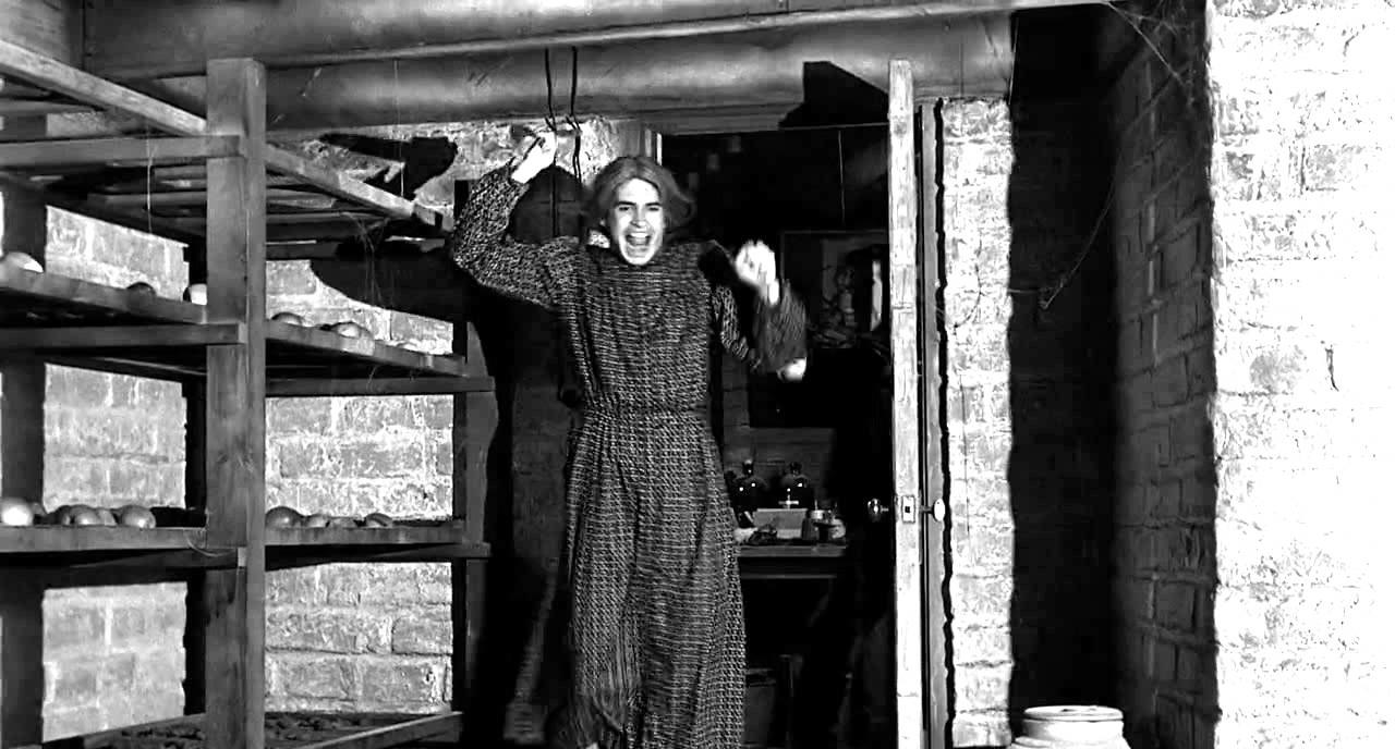 Anthony Perkins dressed as a woman in Psycho