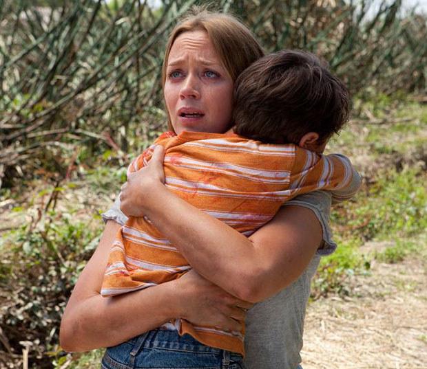 Emily Blunt hugging her child in Looper