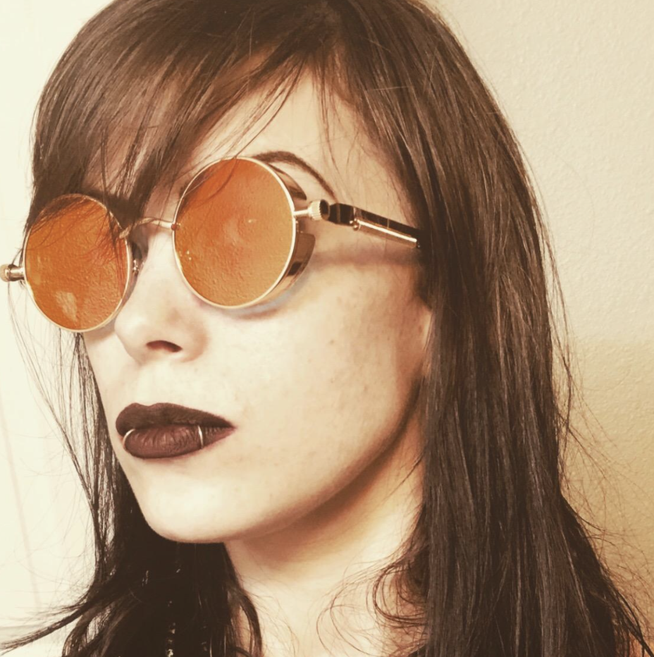 A reviewer wearing the sunglasses
