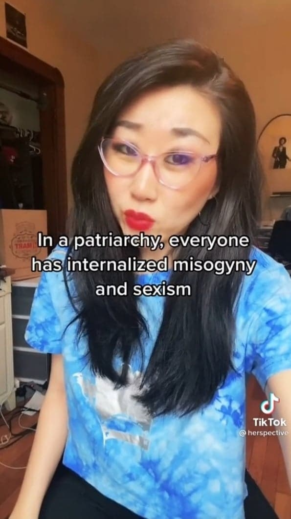 """A screencap from the TikTok with the caption, """"In a patriarchy, everyone has internalized misogyny and sexism"""""""