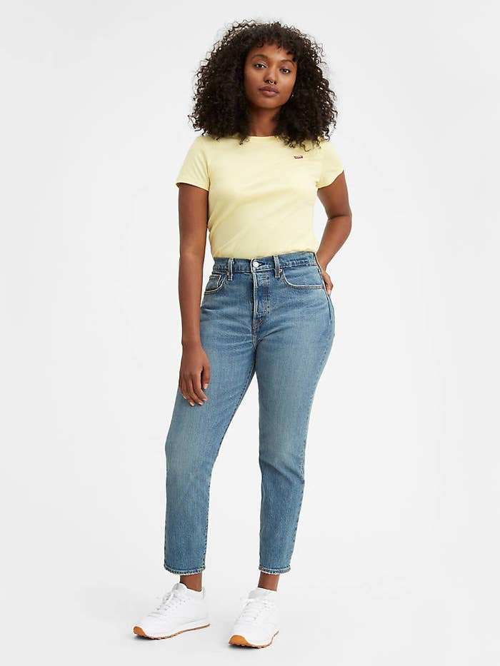 Model in the medium wash jeans
