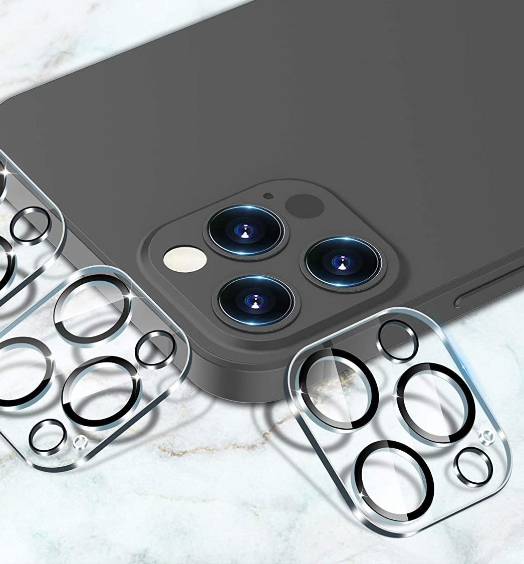 Three lens covers leaning on an iPhone
