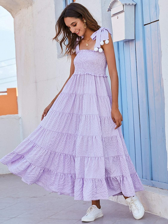 model wearing the purple dress