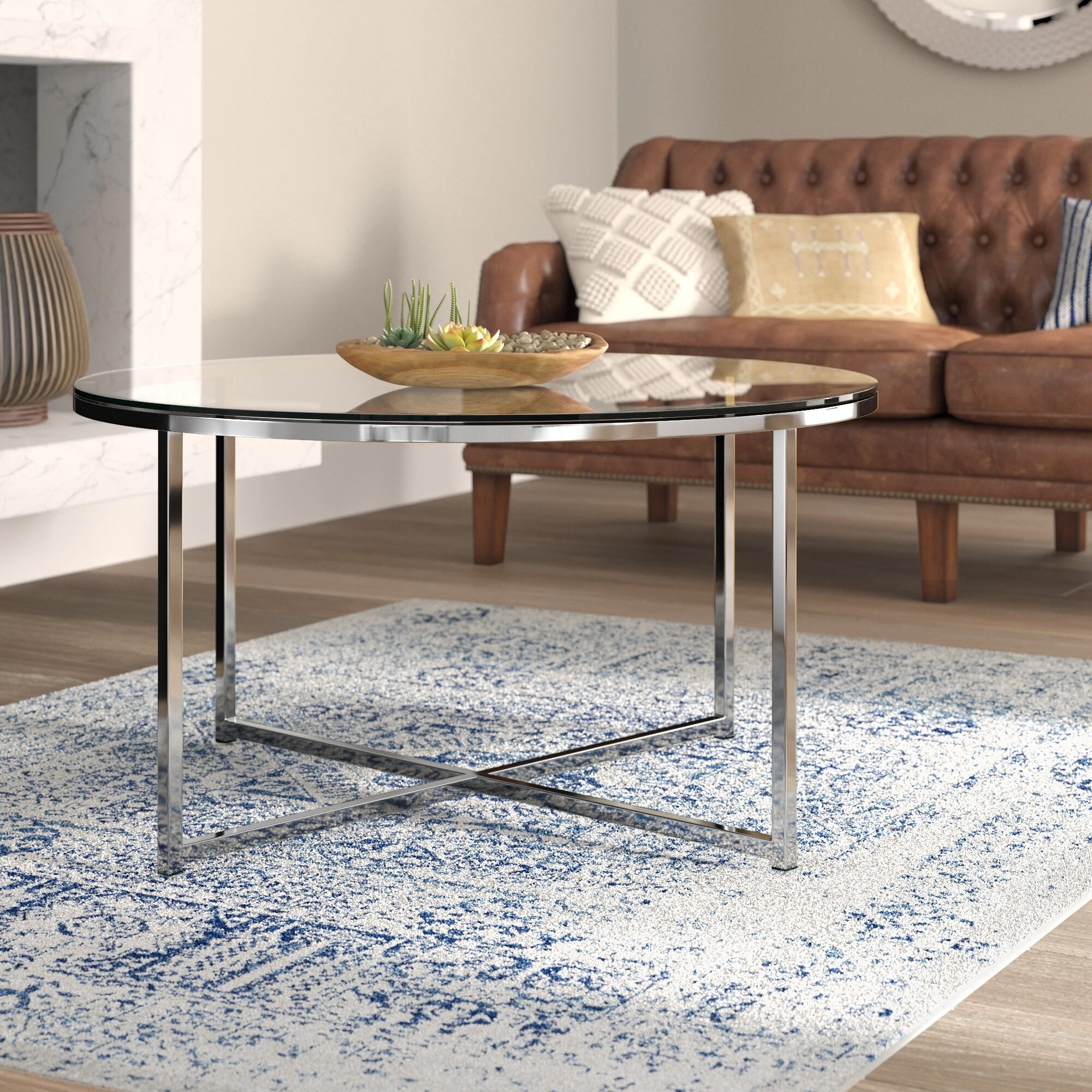 Round table with glass top and silver metal legs