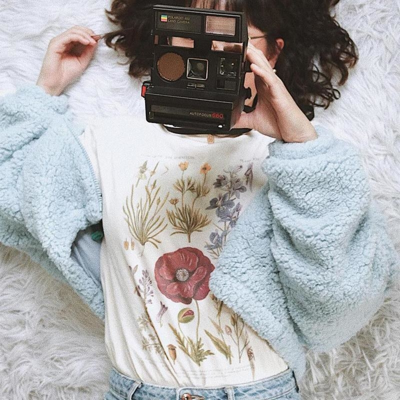 person wearing floral shirt