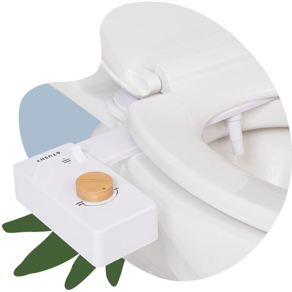 Bidet on toilet seat. It has a bamboo knob.