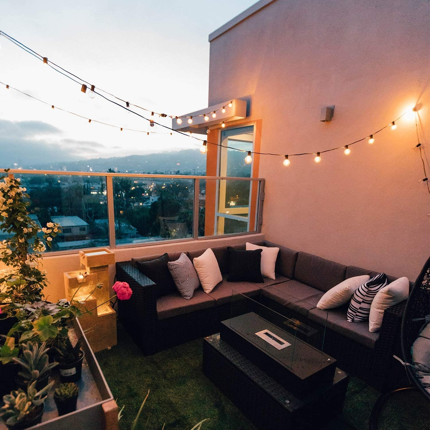 The string lights hung on someone's balcony
