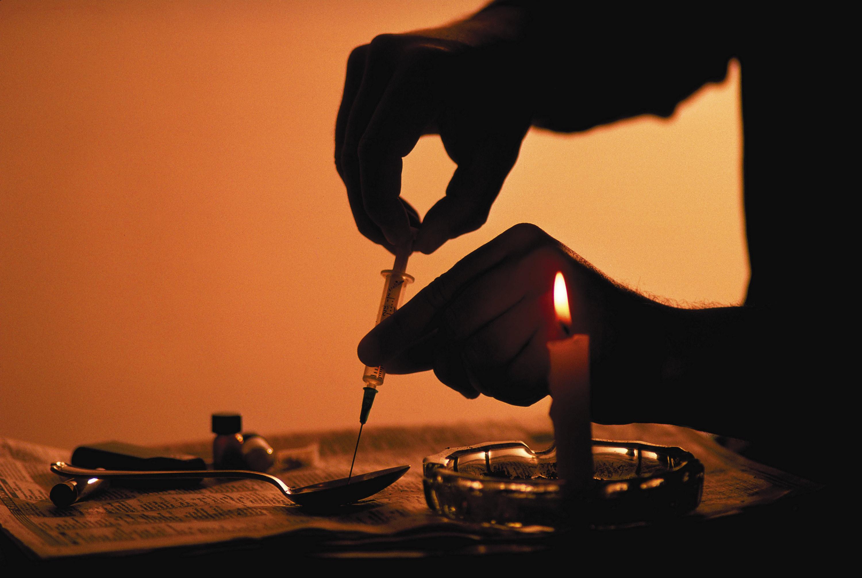 a person preparing heroin