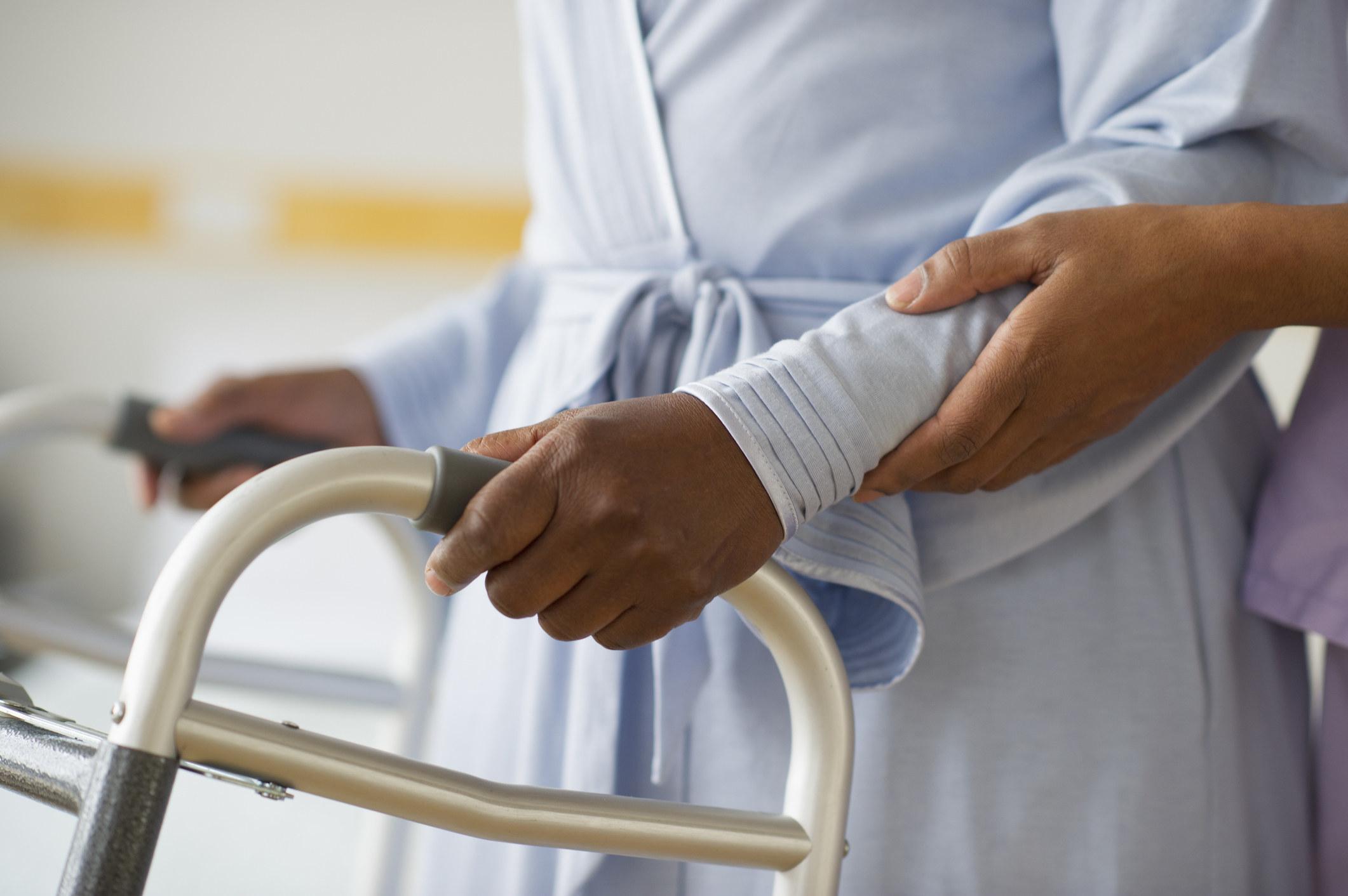 An elderly person in a walker