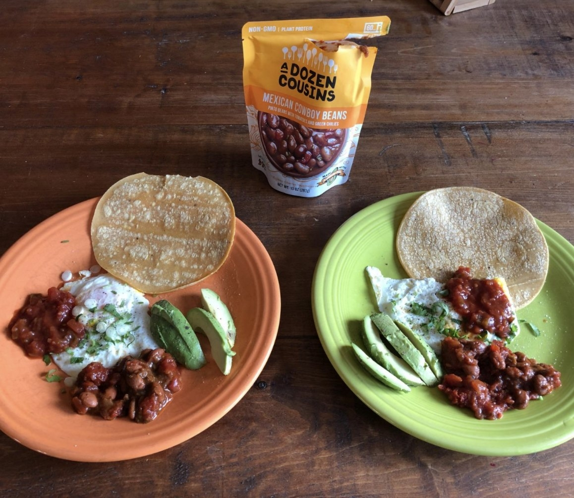 The beans on two dishes with taco ingredients