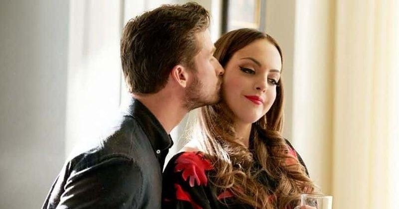 Adam giving Liz's character a kiss on the cheek