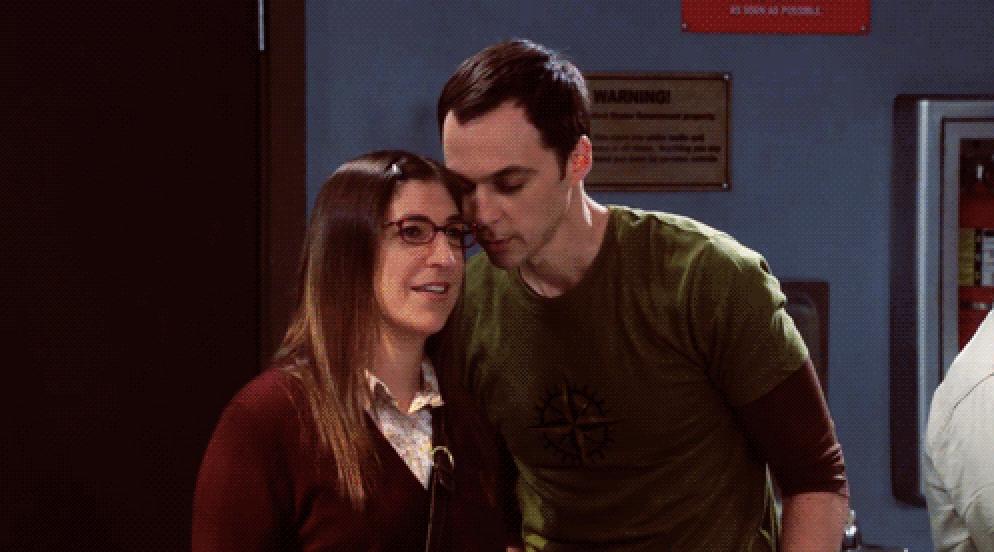 Sheldon and Amy semi-cuddling on the big bag theory