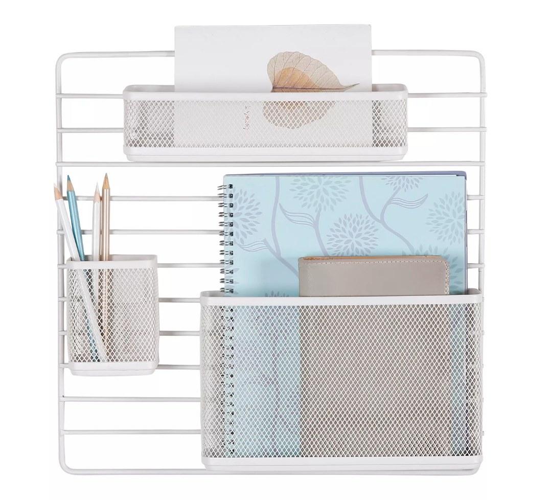 White desk organizer mount with notebook holder, pencil holder, and top bin