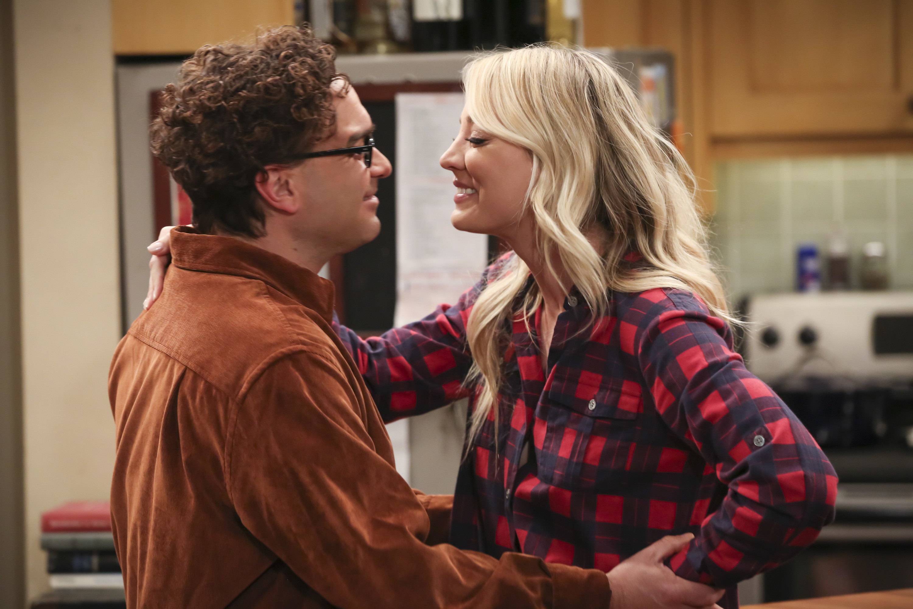 Penny and Leonard look into each other's eyes while embracing