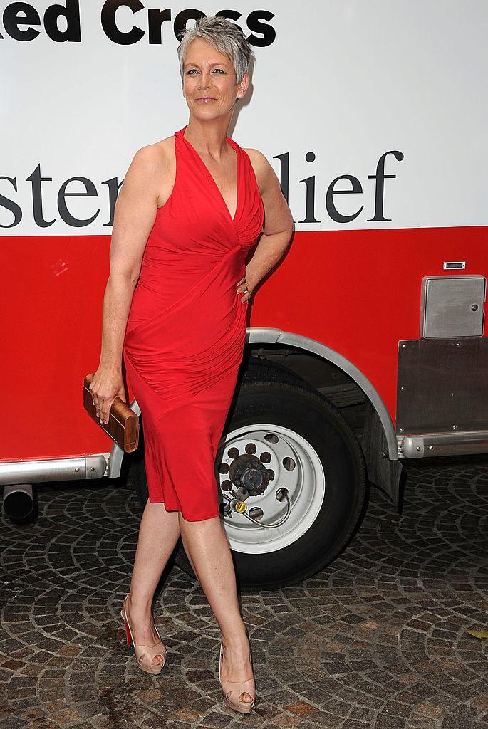 in a red mini dress