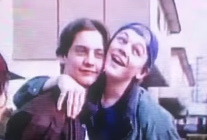 young Leo posing with a young Tobey