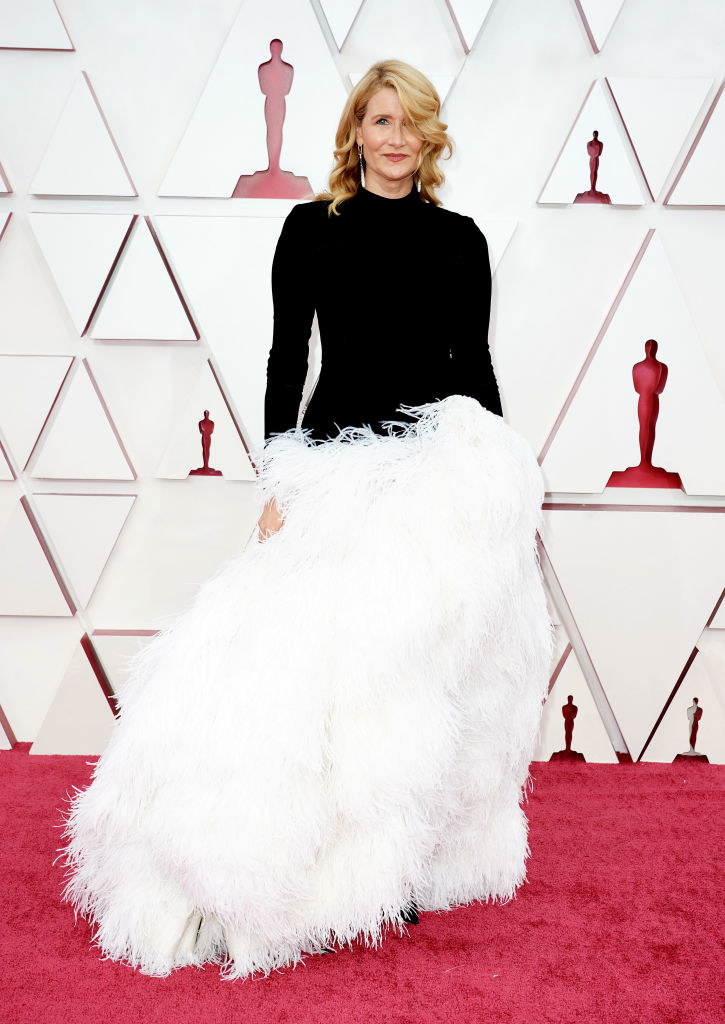at the oscars in a feather gown