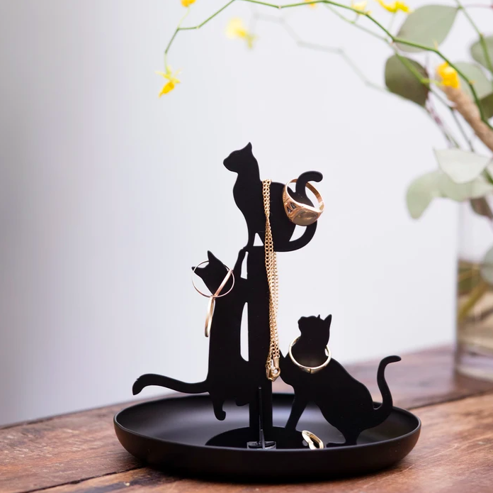 The cat jewellery stand covered in baubles