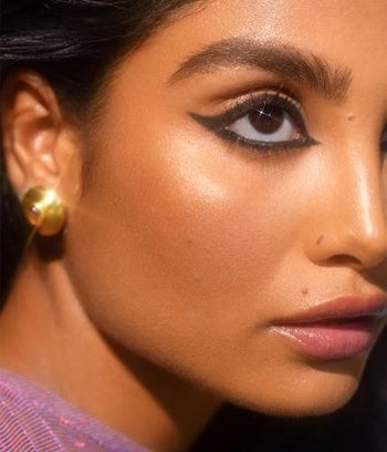 close up of a model with black eyeliner around her eyes