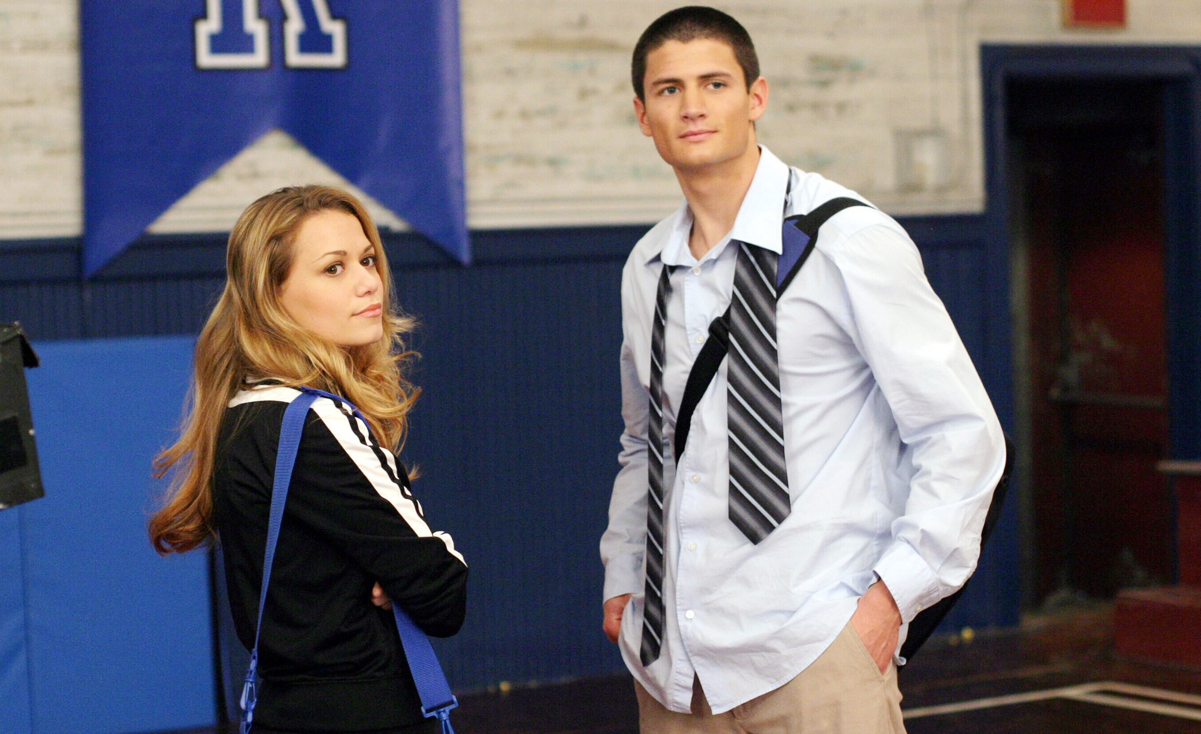 Haley and Nathan standing together but not looking at each other