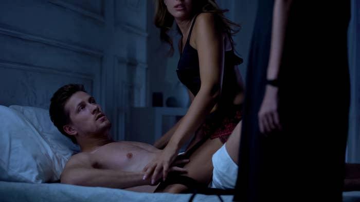 Girlfriend catching boyfriend cheating in bed