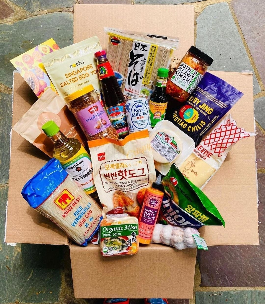an open box filled with different Asian groceries