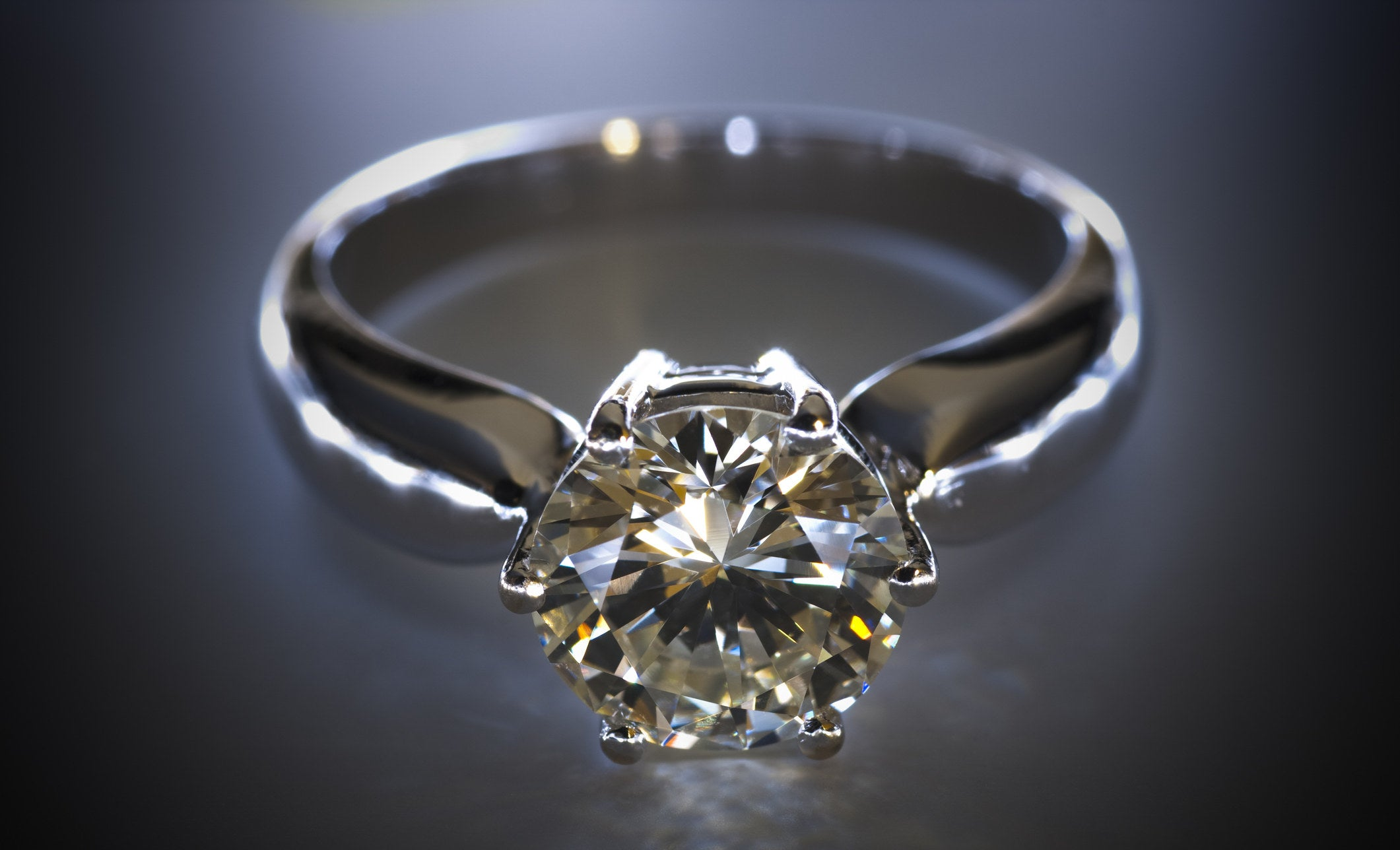 Diamond ring on black table top