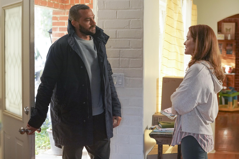 Williams walks through a door towards Sarah Drew in Grey's Anatomy