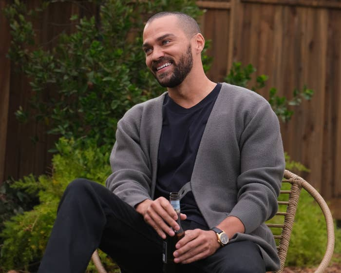 Jesse Williams sits back with a beer in Grey's Anatomy