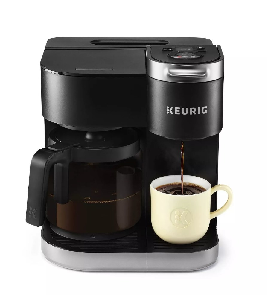 Keurig coffee maker with carafe pot on the left and single serve coffee on the left with coffee pouring into a mug