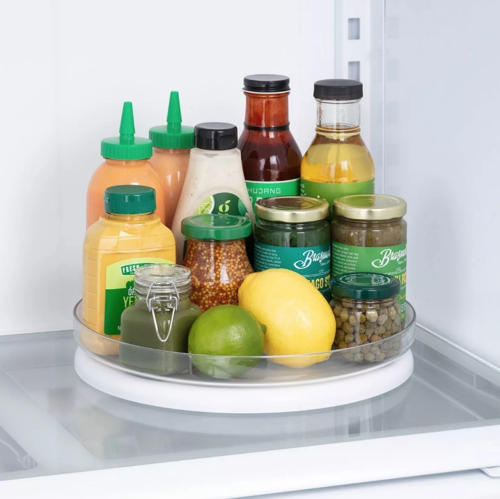 Turntable organizer in fridge with condiments in it