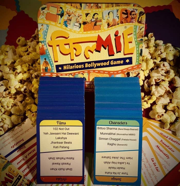 A set of cards next to popcorn