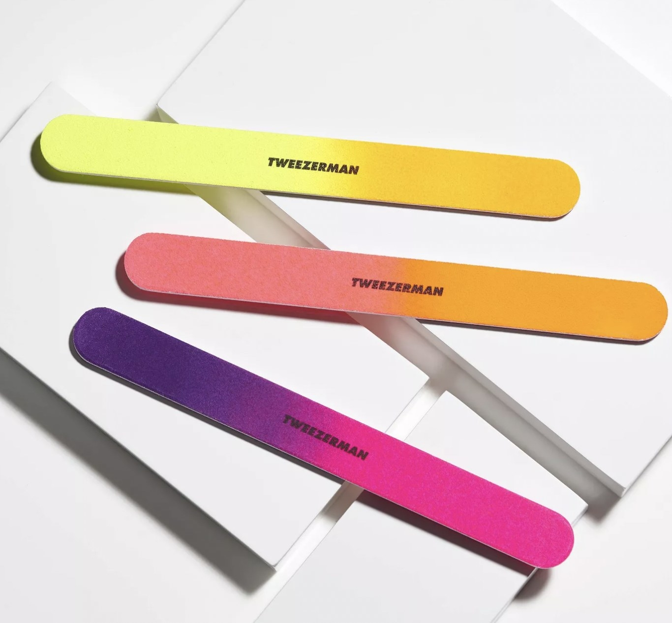 A set of 3 multicolored nail files