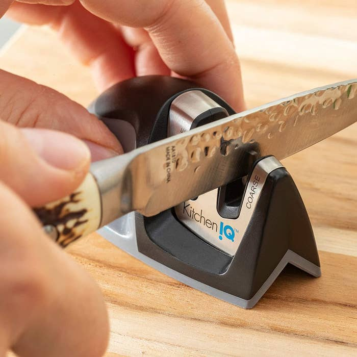 Hand using the sharpener