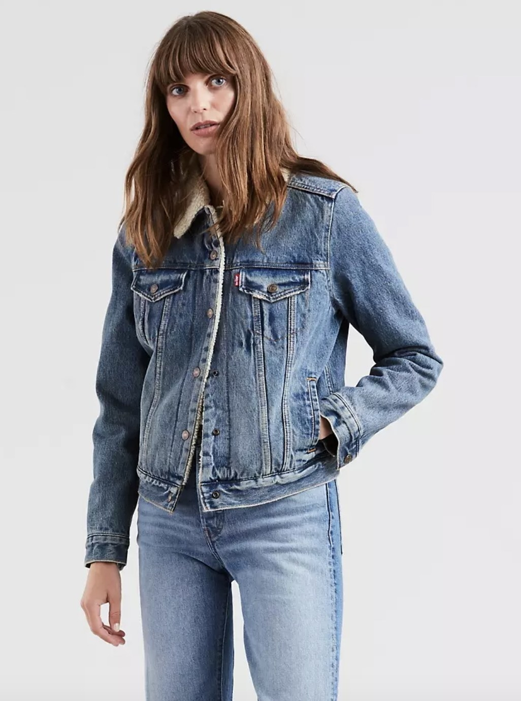 model wearing the jacket with denim jeans