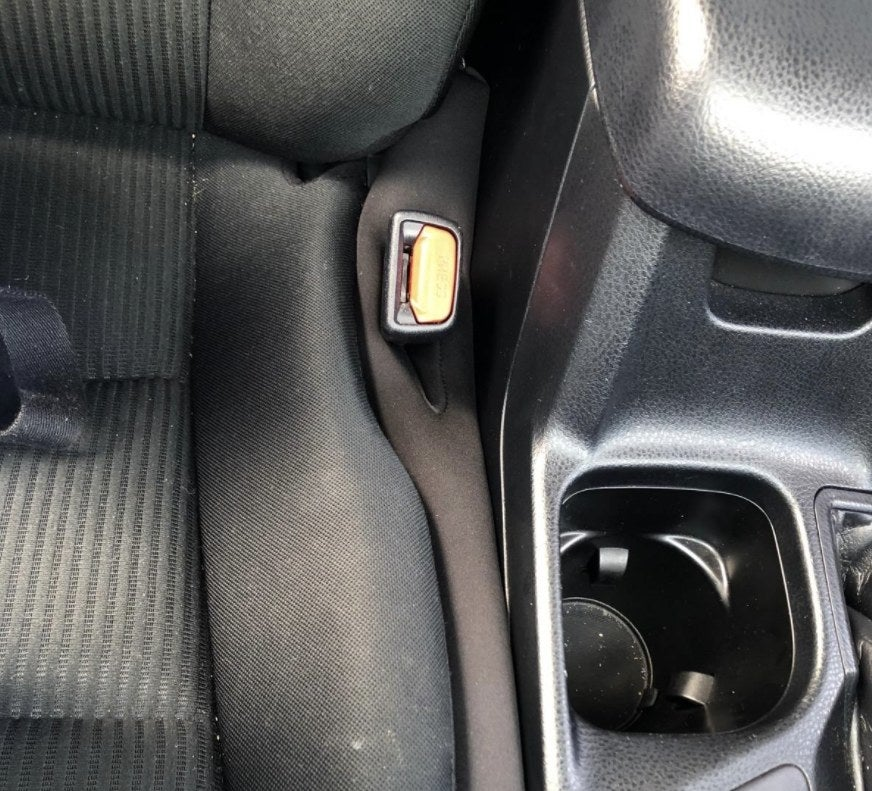 reviewer photo showing the seat gap blocker installed in their vehicle