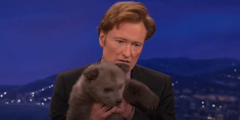 Conan holding bear cub