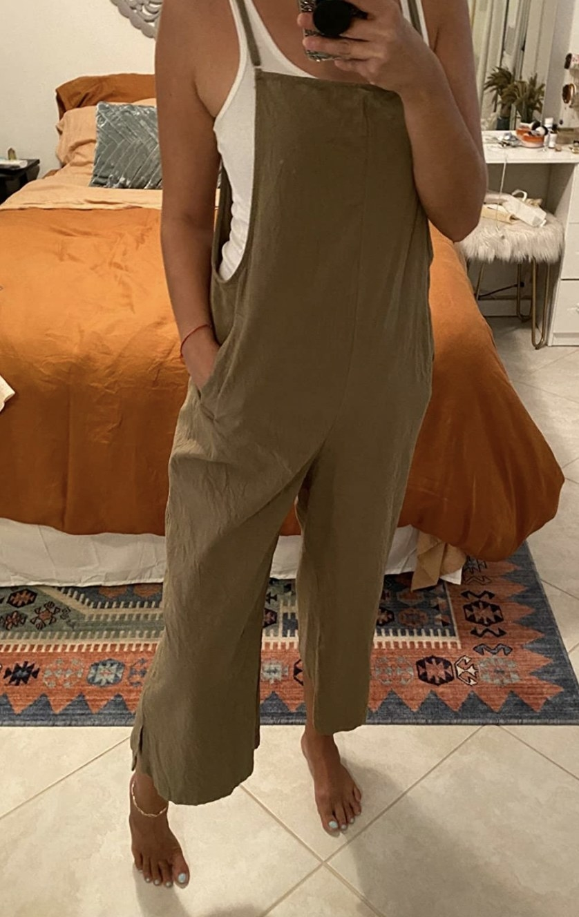 a reviewer wearing olive overalls