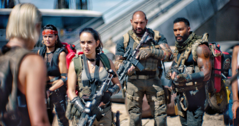 "Nora Arnezeder, Samantha Win, Ana de la Reguera, Dave Bautista, Omari Hardwick holding guns in ""Army of the Dead"""