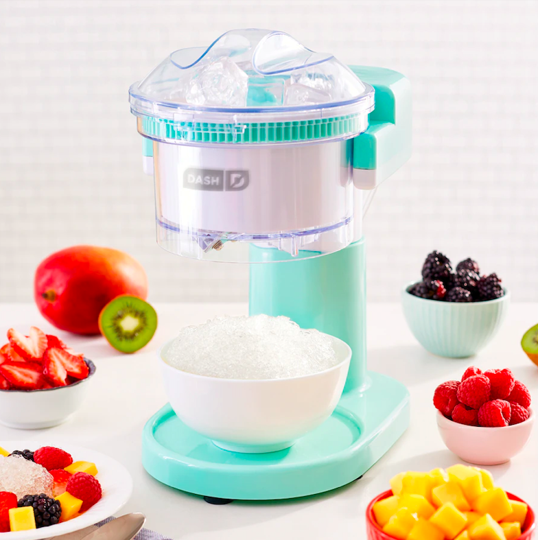 The shaved ice maker surrounded by fruit
