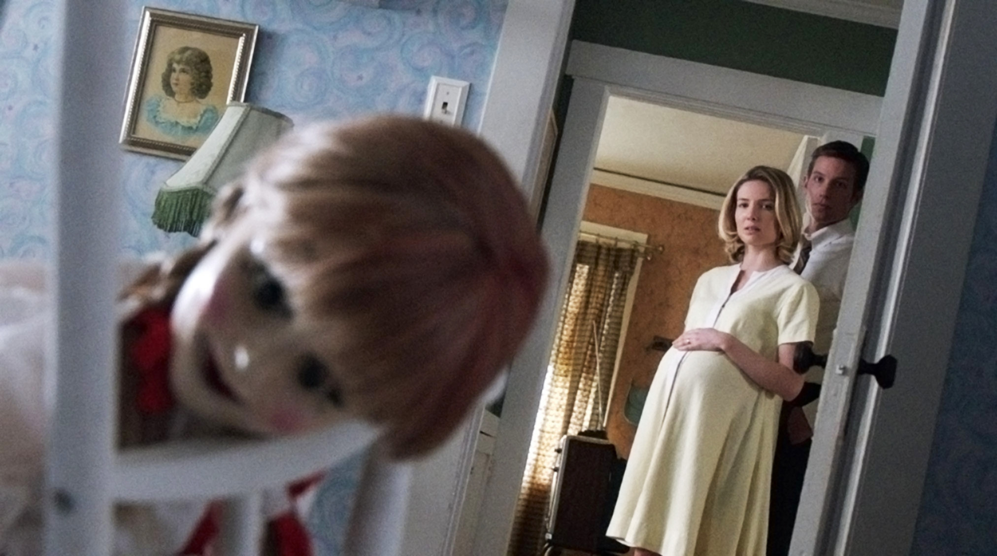 """Annabelle Wallis and Ward Horton looking into their child's room in """"Annabelle"""""""