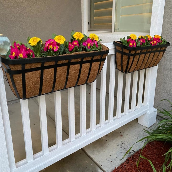 a reviewer image of the steel boxes mounted onto a deck rail and filled with flowers