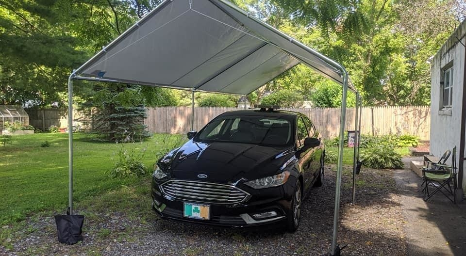 a reviewer's car under the car port