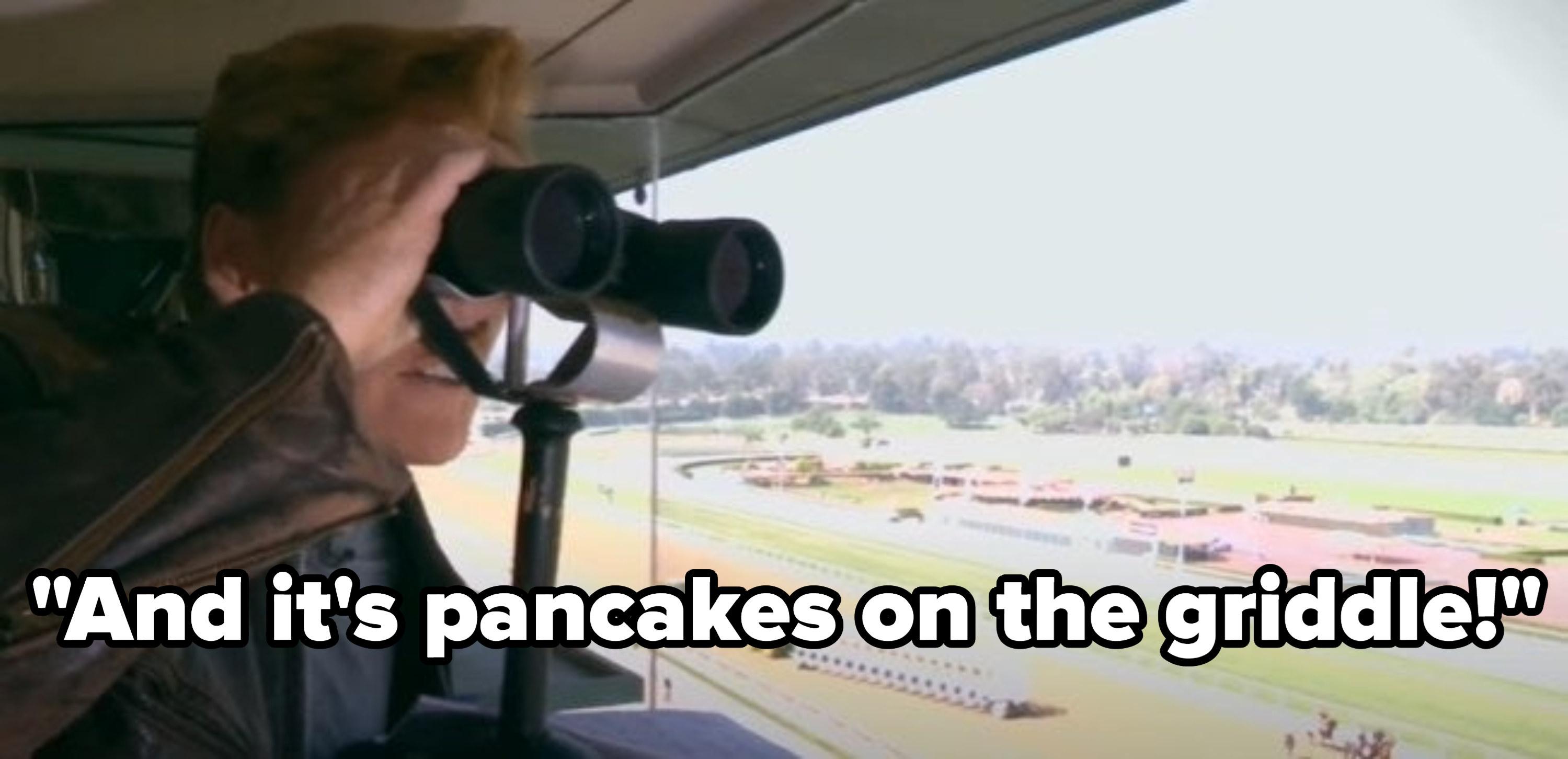 Conan looks through binoculars