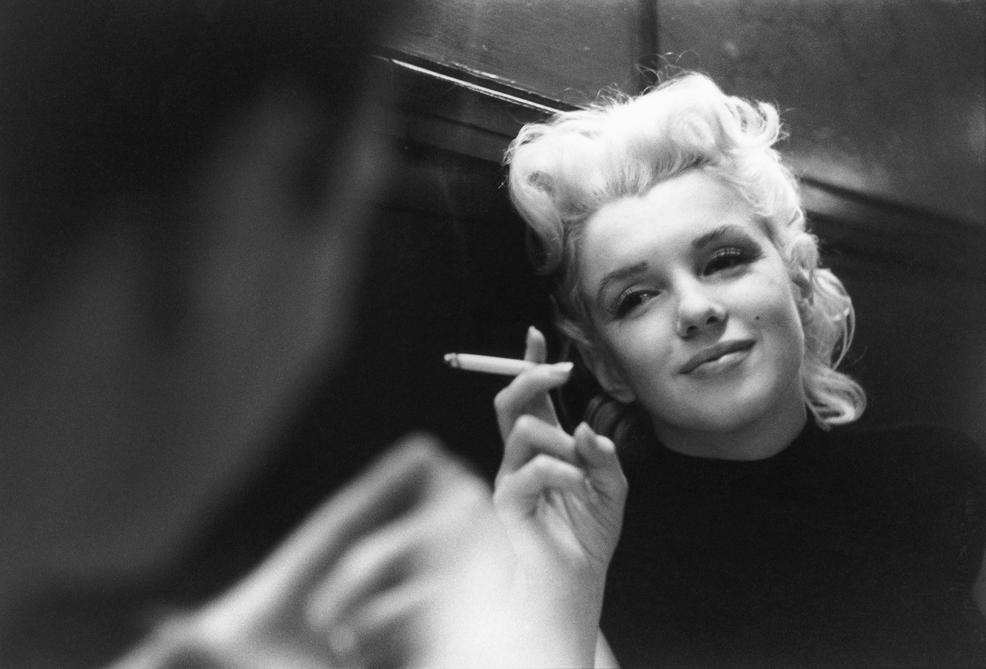 Marilyn Monroe smoking a cigarette