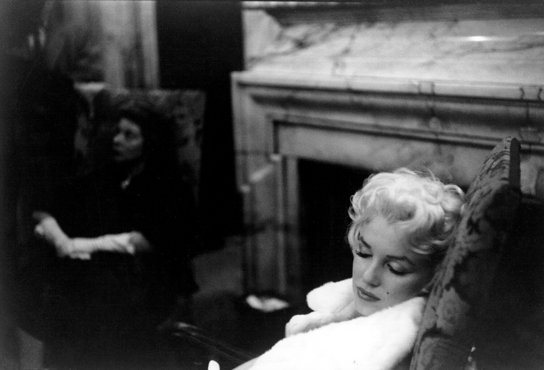 Marilyn Monroe sleeping in a chair