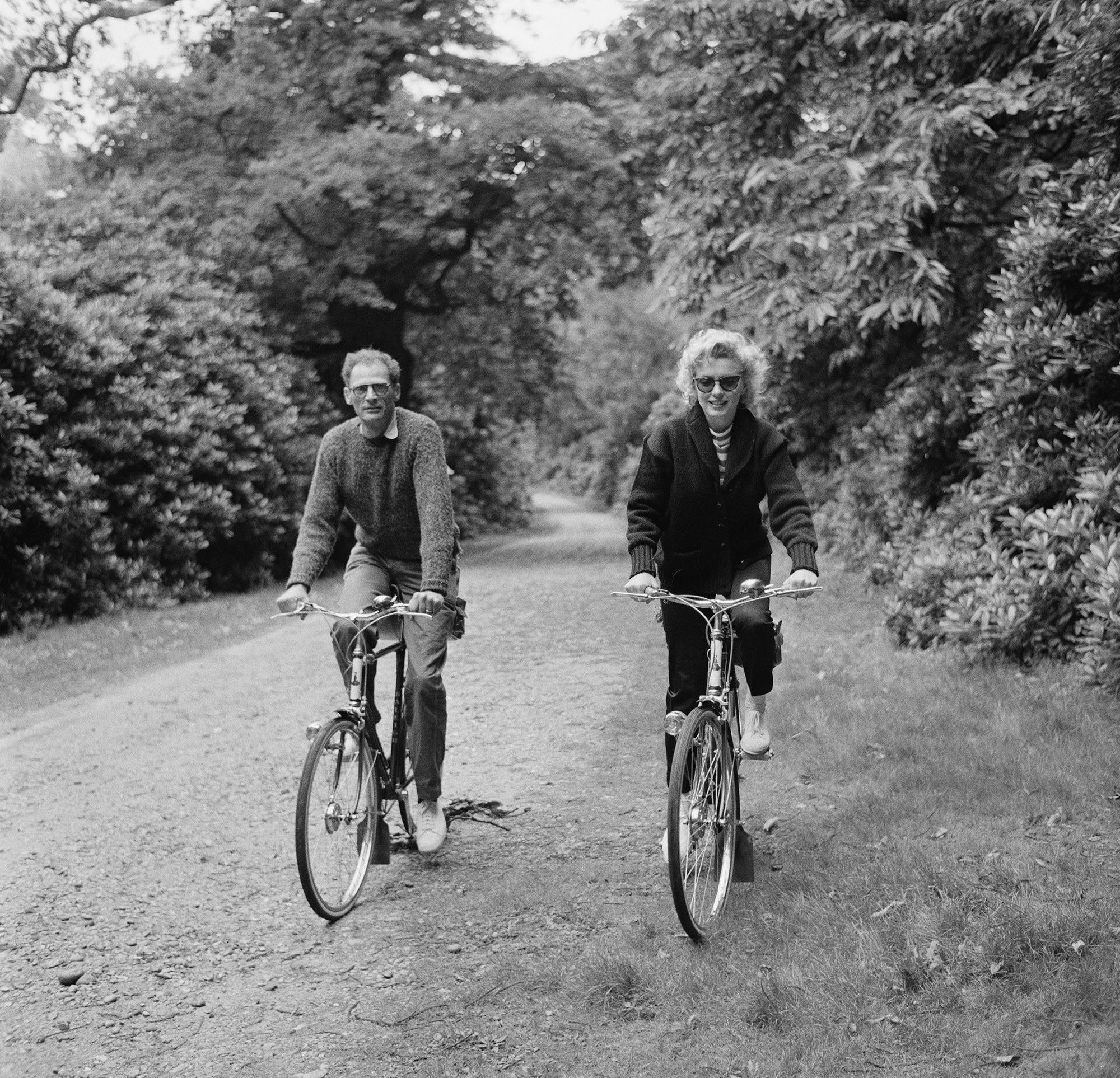Marilyn Monroe riding a bike with her husband