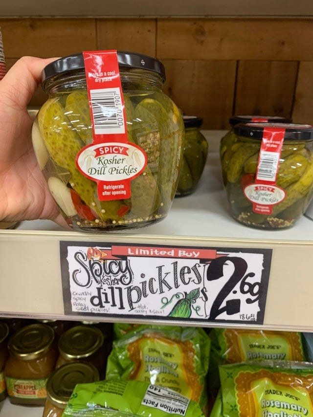 Spicy dill pickles on the shelf.